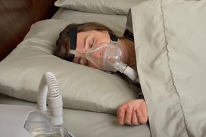 Woman wearing CPAP machine